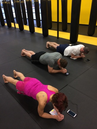Kristina (near), Mike (middle), and Mike's co-worker doing the 6-min plank!