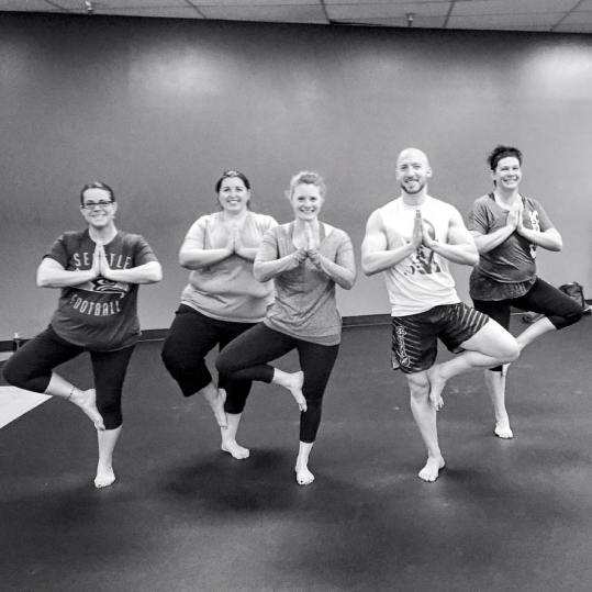 Jessica (center) at the yoga challenge takeover class